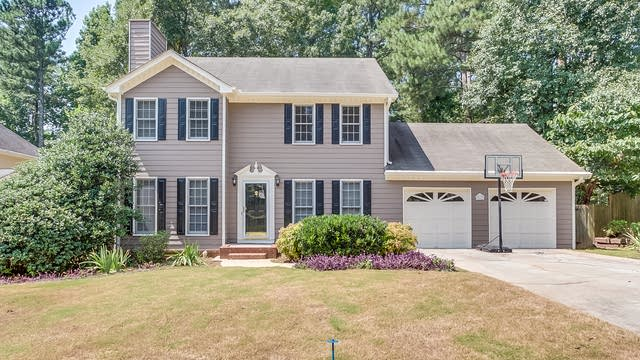 Photo 1 of 20 - 3413 Woodlaurel Dr, Snellville, GA 30078