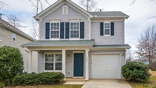 Photo 1 of 15 - 209 Trayesan Dr, Holly Springs, NC 27540