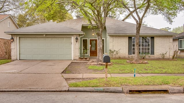 Photo 1 of 14 - 19919 Lions Gate Dr, Humble, TX 77338