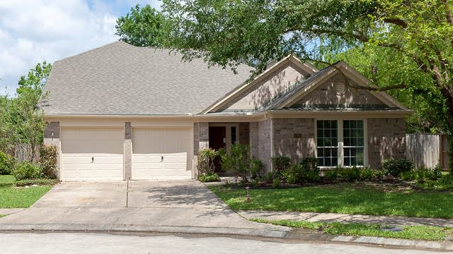 Photo 1 of 20 - 12943 Cascadia Knoll Ct, Humble, TX 77346