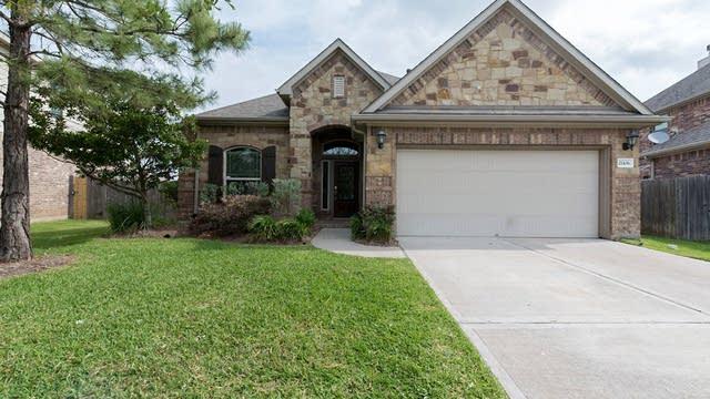 Photo 1 of 21 - 21106 Barrett Creek Ln, Richmond, TX 77407