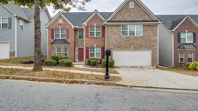 Photo 1 of 24 - 4656 Beau Point Ct, Snellville, GA 30039