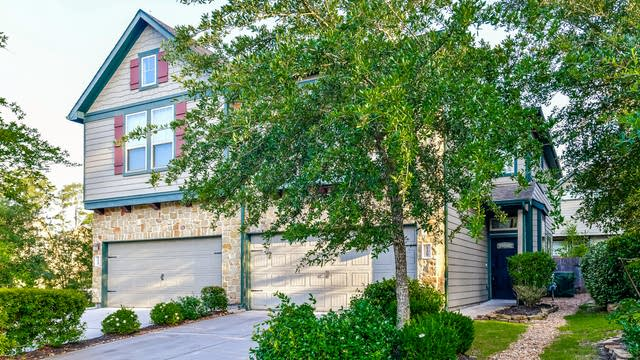 Photo 1 of 25 - 129 Cheswood Manor Dr, Spring, TX 77382