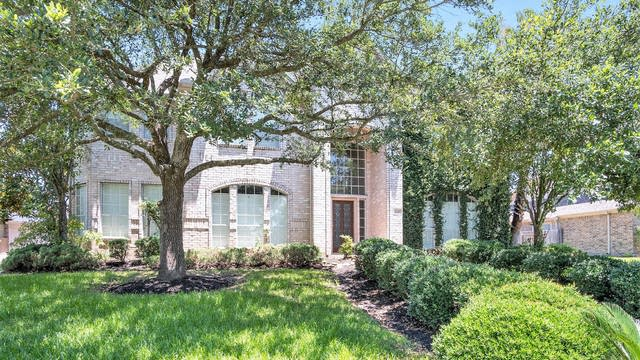 Photo 1 of 17 - 5710 Winding Spring Dr, Spring, TX 77379