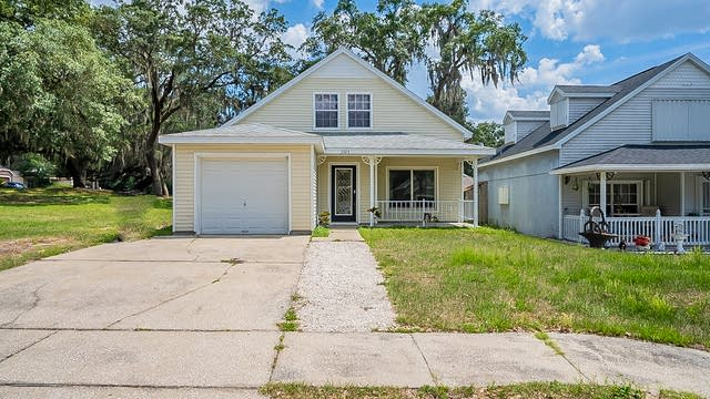 Photo 1 of 25 - 5323 Regal Oak Cir, Orlando, FL 32810